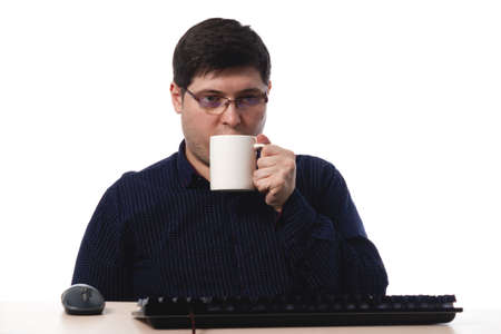 A young guy in a blue shirt with glasses for vision drinks with a coffee cup. office worker, business. on white background. isolate. copy space