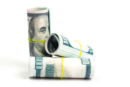 rolls with hundred dollar bills on a white background isolate, side view Stock Photo
