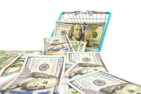 a fallen basket with blue inserts is inserted into one hundred dollar bills on a white background. isolate