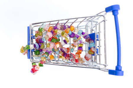shopping cart with beads of multi-colored gemstones on a white background. isolate, top view Stock Photo