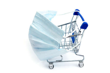 shopping cart with coronavirus medical mask on a white background, isolate