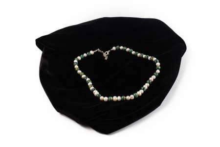 beads from natural Jasper, River Pearls on black velvet. On a white background isolate