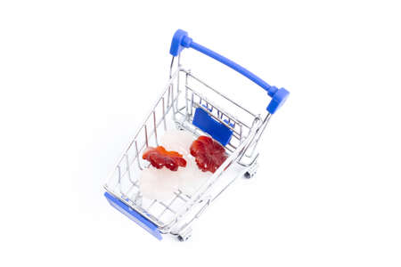 shopping cart with gemstones flowers on a white background. isolate