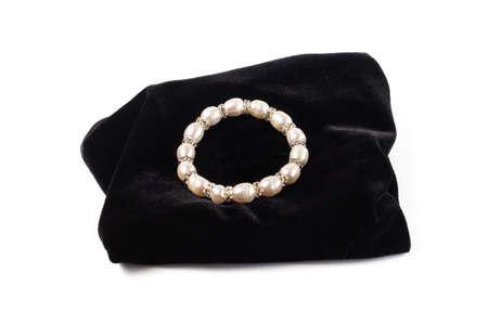 bracelet made of natural River pearls on black velvet. On a white background isolate