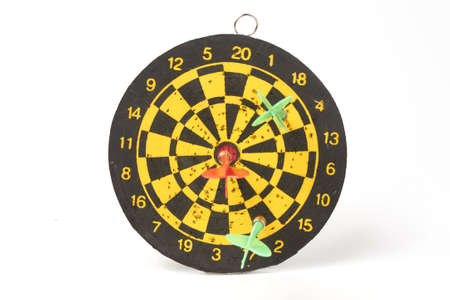 darts target darts all in holes with two green darts and one red on a white background isolate Imagens