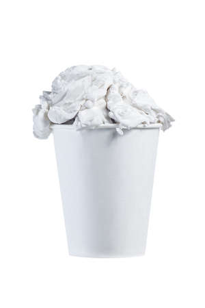 white balls of ice cream in a white paper cup on a white background isolate. close, copy space.