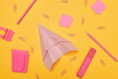 Minimalism, Back to school concept pink school supplies on yellow background, flat lay with Zdjęcie Seryjne