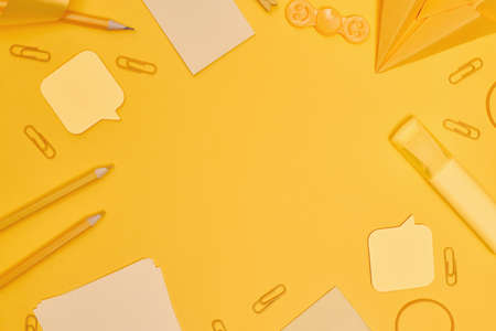 Minimalism, Back to school concept Yellow school supplies on yellow background, flat lay copy space