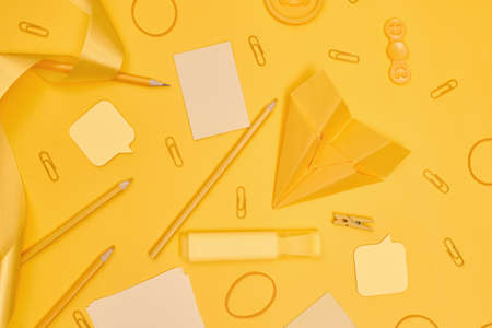 Minimalism, Back to school concept Yellow school supplies on yellow background, flat lay with