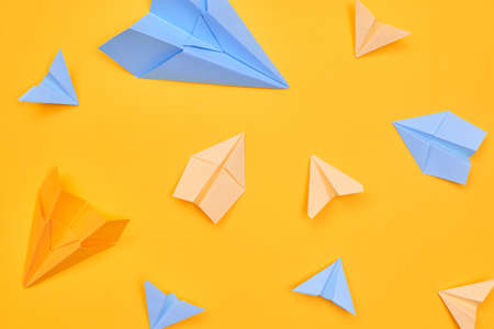 paper planes on a yellow background. travel flat layer,one Banco de Imagens