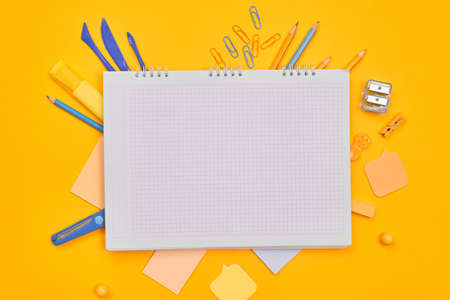 minimalism notebook stationery on a yellow background.MOCKUP, school, university, flat layer, copy space one 免版税图像