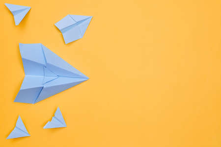 minimalism blue paper planes on a yellow background. travel, flight, flat layer, copy space one