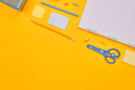 minimalism yellow-blue stationery on yellow background school, university, flat layer, copy space one