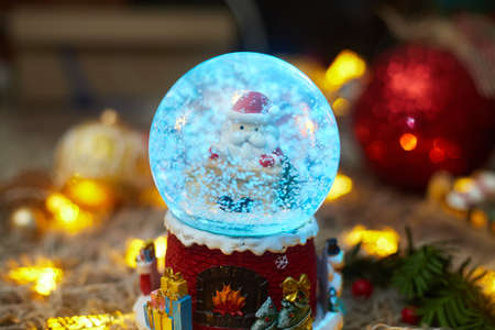 christmas ball with snow and santa claus and toys, bokeh, flatley, copy space