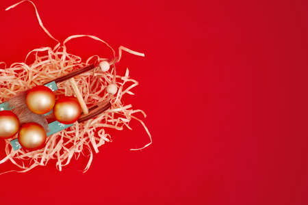 Christmas composition, gifts on red background, copyspace