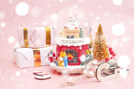 Christmas composition, gifts on pastel pink background, copyspace