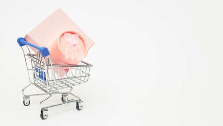 black friday concept, gift boxes with shopping trolley on white background, copy space