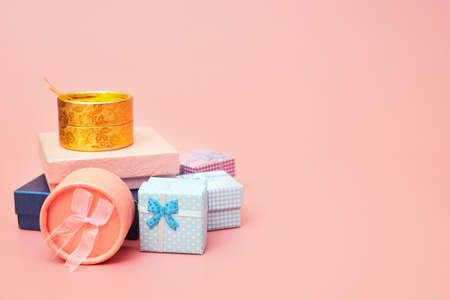 Gift boxes on a pink pastel background, copies space, flatlay