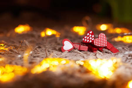 valentines day concept, red hearts with garland, copy space