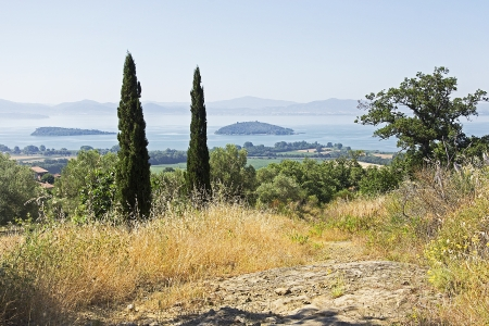 view on the Isola Maggiore and Isola Minore in the lake of Trasimeno, Italy Standard-Bild