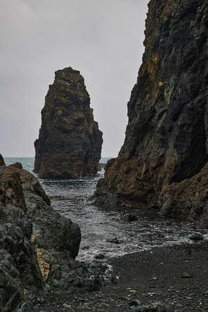 set of rocks on Tra na mBo beach. Coast of Cooper Ireland. vertical format.