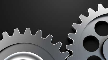 Two cogwheels together on dark surface Stock Photo