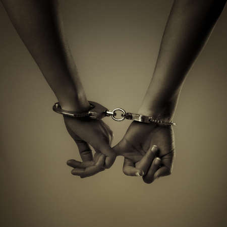 two girl hand and handcuffs, love symbol Stock Photo