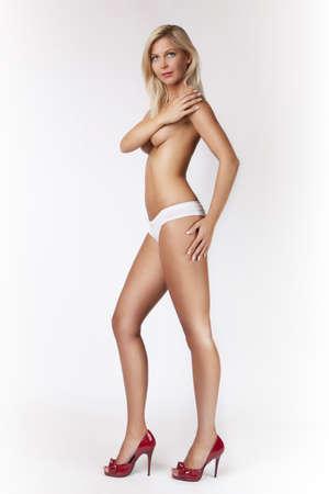 legs heels: glamour blond gir in red heels, long legs