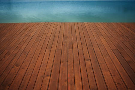 boat deck: Wooden wharf and blue water