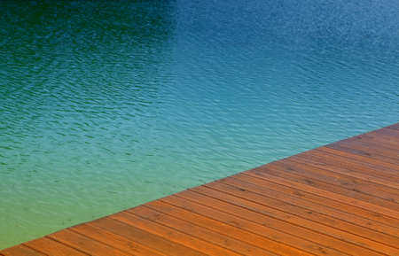 Wooden wharf and blue water, summer scene photo