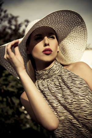 beautiful summer fashion girl with hat photo