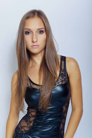sexy young brunette girl in black clothing photo