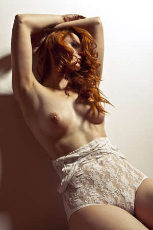 red breast: sexy nude young girl pose, red hair
