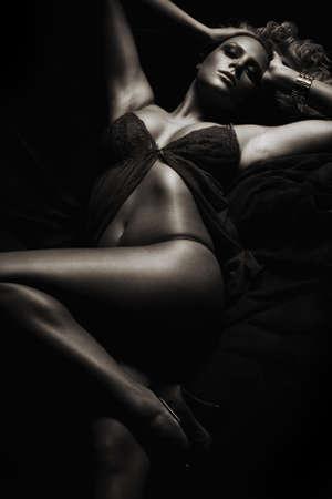 lying attractive blond girl in dark