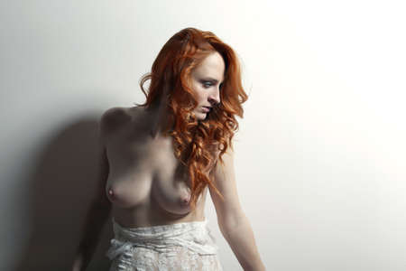 beautiful breasts: beautiful sexy nude girl with red heair Stock Photo