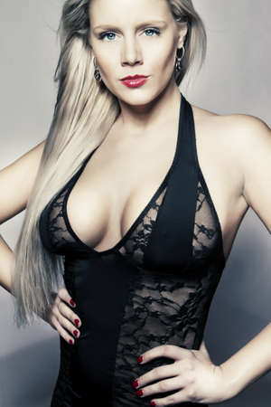 young blond girl in black lingerie with big breasts Stock Photo - 12411937