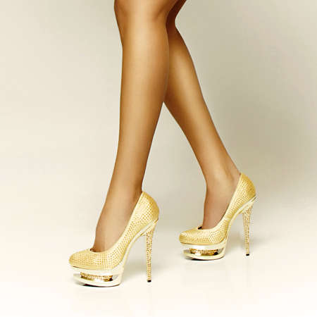 sexy gold girl shoes, long sexy legs Stock Photo - 13548502