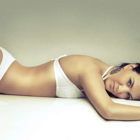 slim beautiful girl relax in white swimsuit photo
