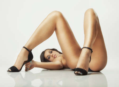 sexy glamour pose girl lying on white floor photo