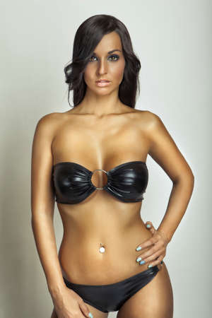 hot girl nude: attractive girl with big breasts in black swimsuit