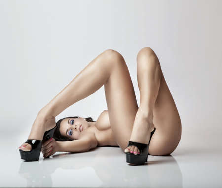 sexy glamour pose girl lying on white floor