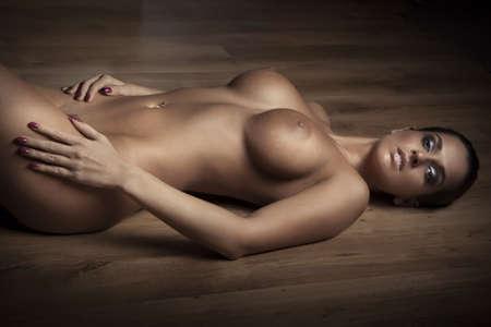 naked woman: Привлекательные девушки ню с большой грудью на полу Фото со стока