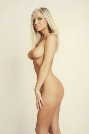 female nudity: attractive glamour nude young blonde girl