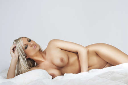 nudes attractive blonde girl relax in bed Stock Photo