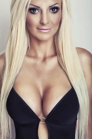 attractive blonde girl portrait with big breasts