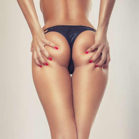 mujeres eroticas: curvas sexy girl butt, sin celulitis Foto de archivo