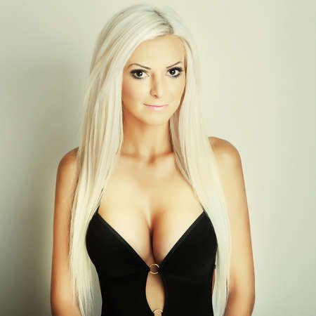 attractive blonde girl portrait with big breasts photo