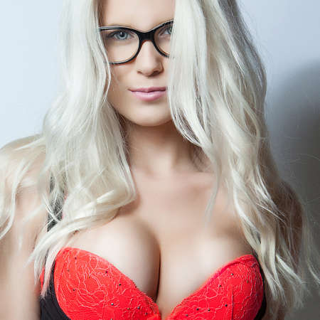 young girls breast: attractive blonde girl in red bra Stock Photo