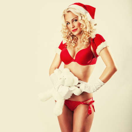 very beautiful and sexy woman dresses as a sexy santa claus photo