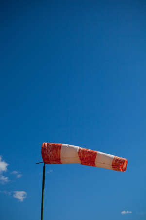 wind red and white sock against a blue sky photo